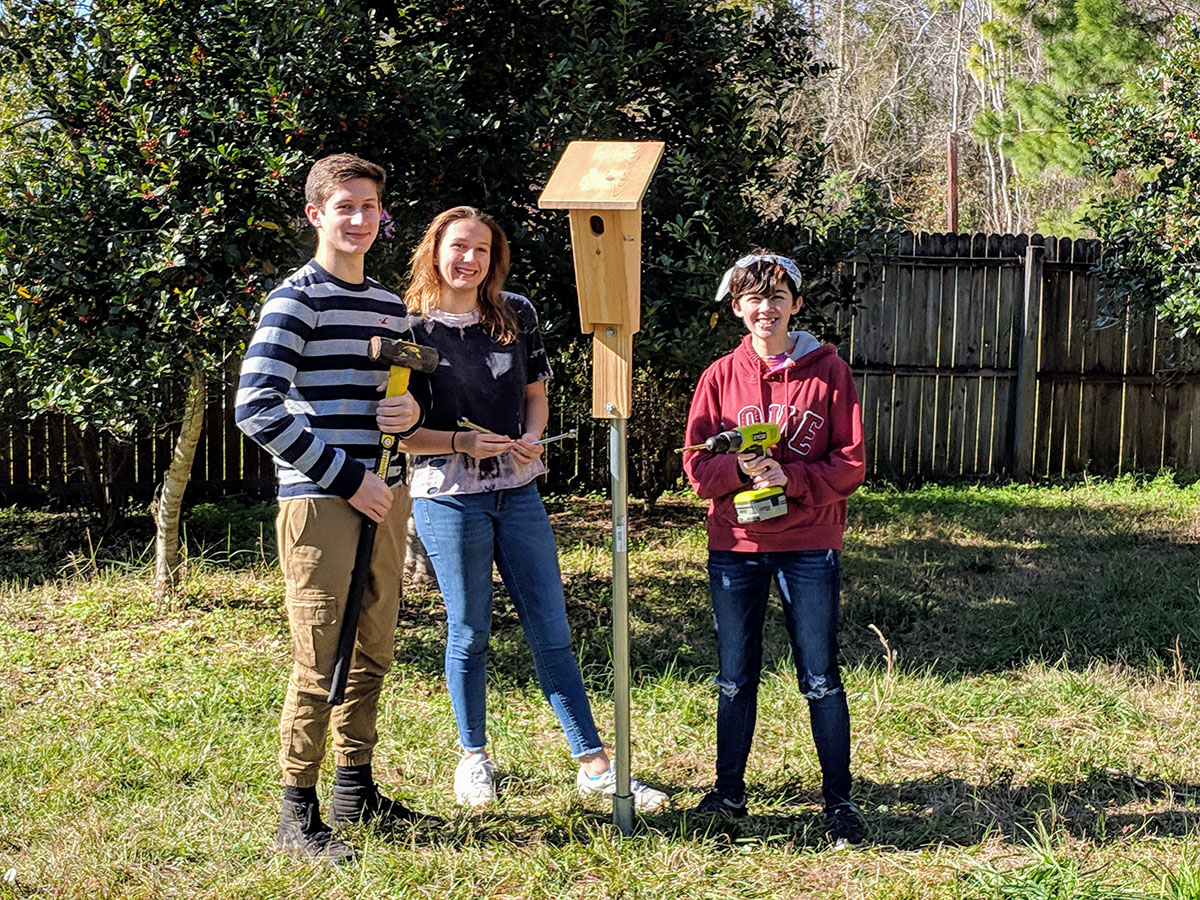 Students from Ridgeview HS Earth Club with Bluebird nesting box